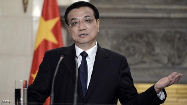 Chinese Prime Minister Li Keqiang gestures as he speaks alongside his Greek counterpart during a joint press conference at the Maximos Mansion in Athens after a meeting, on June 19, 2014. Li is in Greece on a three day official visit during which both sides are expected to sign bilateral agreements. AFP PHOTO / LOUISA GOULIAMAKI        (Photo credit should read LOUISA GOULIAMAKI/AFP/Getty Images)